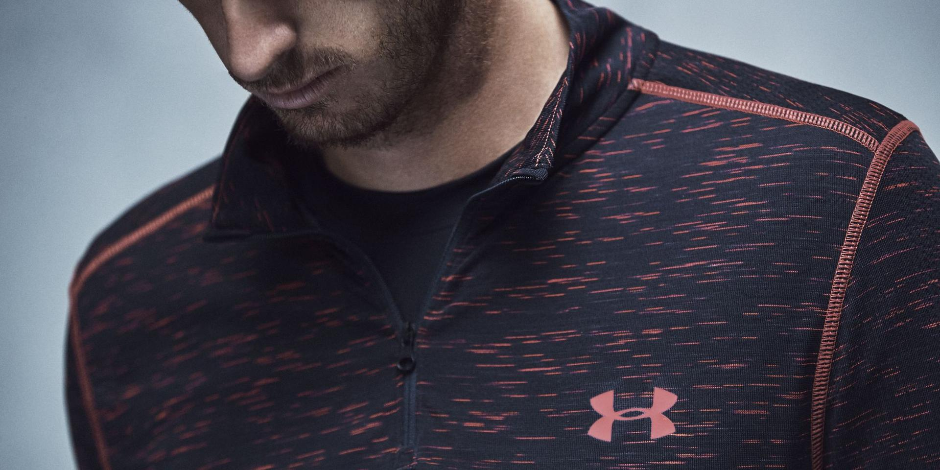 Sportler trägt ein Longsleeve mit Under Armour Threadborne Technologie