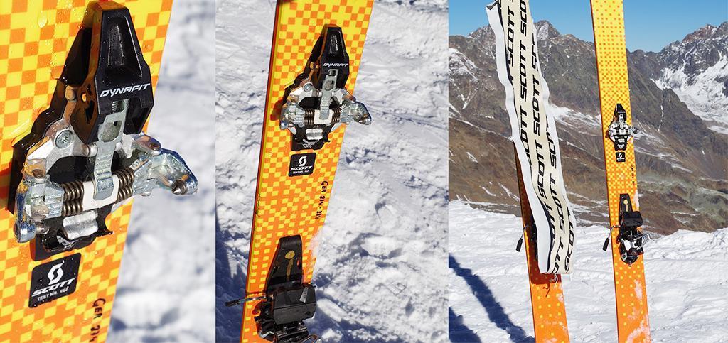 Dynafit Tourenbindungen in der Nahaufnahme an Skiern montiert, die im Schnee stecken.